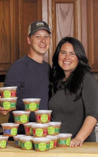 Kelly and Jay Towle in Front of Plucked Fresh Salsa Containers