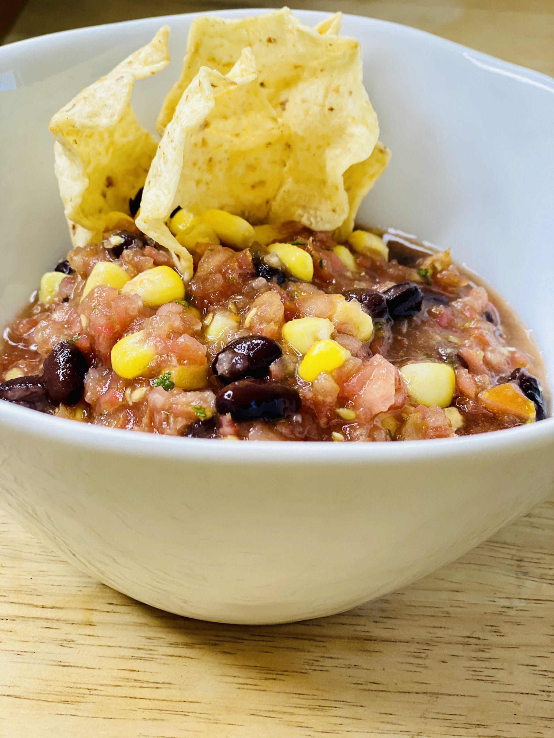 Plucked salsa black bean dip with tortilla chip